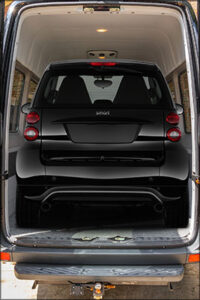 Smart Car Inside Van In Black