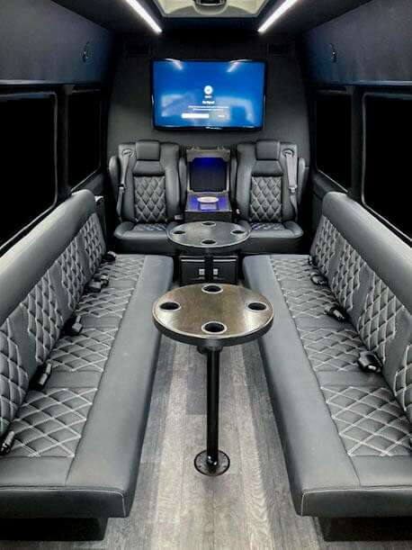 Van in Black Sprinter Limo